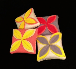 PHOTO: Hand-sewn square sachets are decorated with felted leaves.