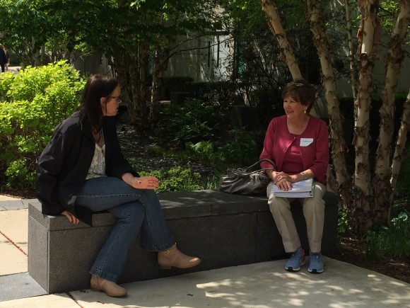 PHOTO: Participants rest in the shade of a garden during a site visit as part of the Healthcare Garden Design course.