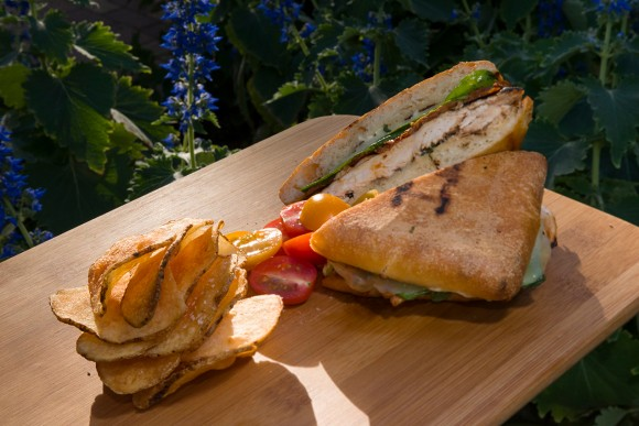 Sandwich of grilled chicken breast, local white cheddar, roasted tomato, lemon-basil mayo, sourdough ciabatta.