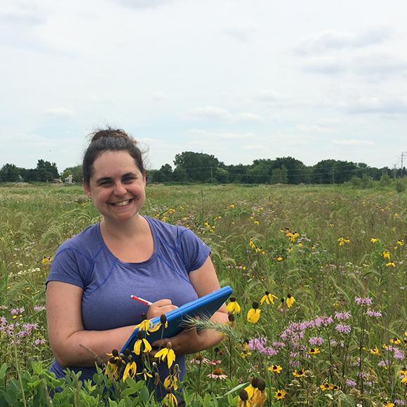 Ph. D. student Becky Barak studies plant diversity in restored tallgrass prairies.