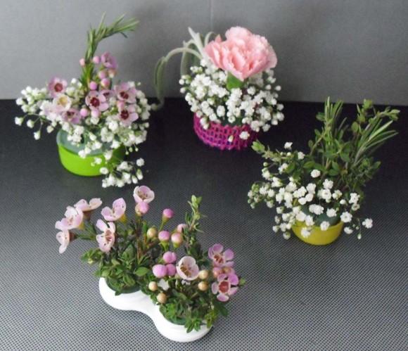 PHOTO: the final bottlcap bouquet arrangements in a group.