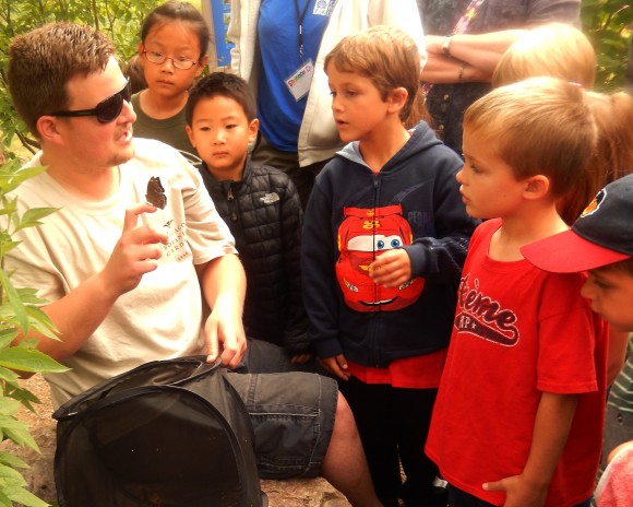Patrick Sbordone talks butterflies with a group of younger visitors.