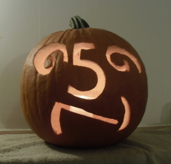PHOTO: Pumpkin with carved numbers for facial features.