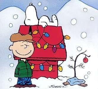 Charlie Brown and Snoopy with a sad-looking, needle-free tree sporting a single ornament.
