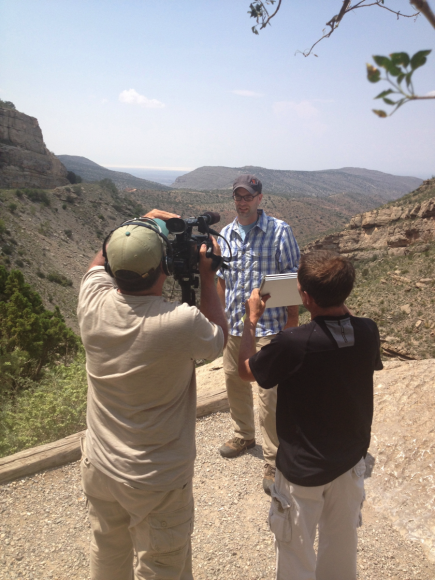 PHOTO: Chris Martine and cameramen filming against New Mexico scenery.