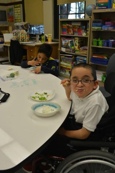 PHOTO: Student eating herb dip.