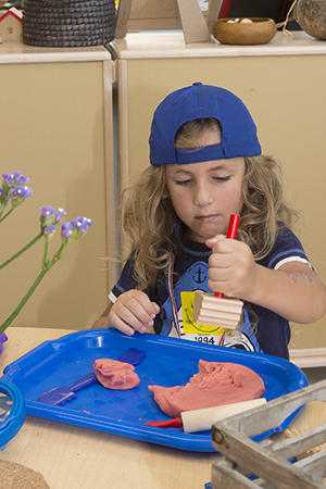 PHOTO: Ethan works with homemade play dough.