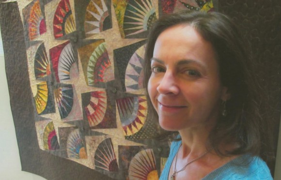 """PHOTO: Amy Spungen with her quilt, """"Fanfare"""""""