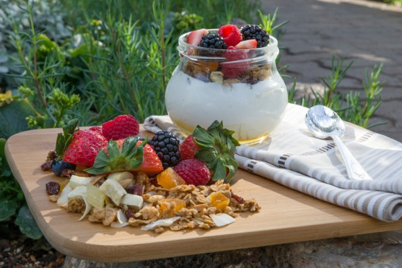 Yogurt with honey and fresh granola and berries.