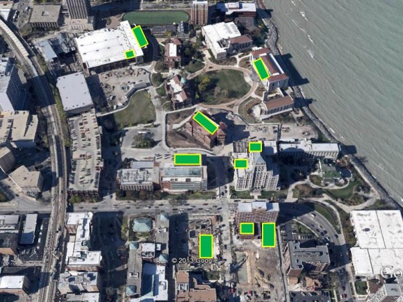 PHOTO: Aerial view of Chicago at Lake Michigan, with green rectangles superimposed over building which house green roofs.