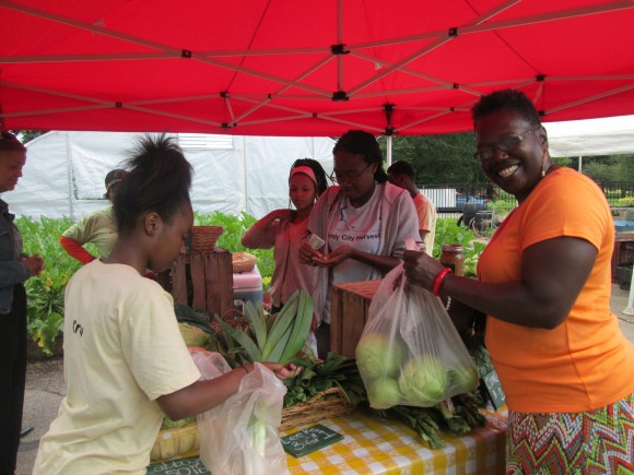 PHOTO: Happy customer at the first market.