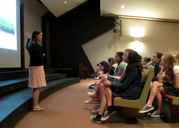 PHOTO: Ksiazek presents her work to a girls' middle school.