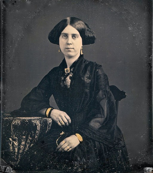 Victorian Lady in Black wearing mourning jewelry and clothing.