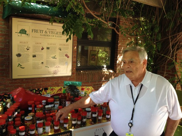 Volunteer Larry Aronson at the Pepper Discovery Cart.