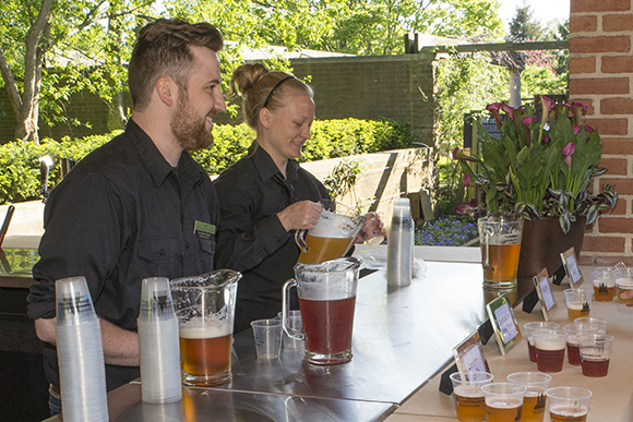 Beverage supervisor Matt Sherry and colleague prepare for our beer garden's grand opening this past summer.