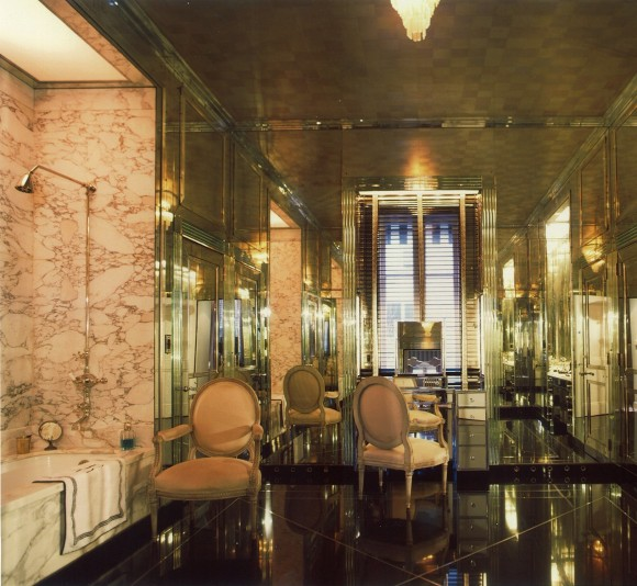 PHOTO: High ceilings accentuate a bathroom finished in mirror and Italian marble.