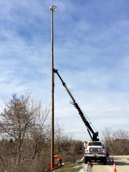 PHOTO: Installing and osprey nesting pole.