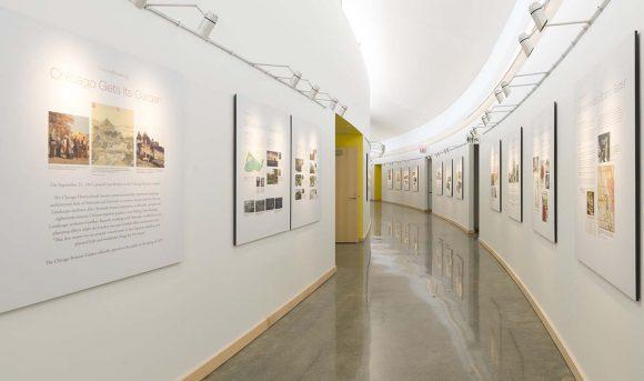 Natural daylight from clerestory windows illuminates the building's main hallway.