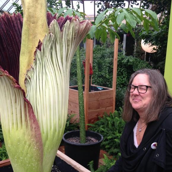 Schoolteacher Jody Schatz reacts to Sprout the titan arum's smell.