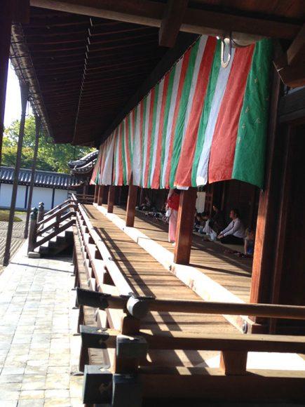 PHOTO: Visitors sitting quietly and gazing at the dry garden at Tofuku-ji.