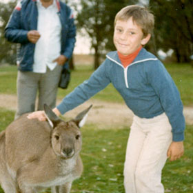 Jeremie, age 6, at home in Adelaide, Australia, with a friendly kangaroo