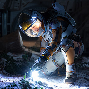Mark Watney may be a biologist, but here he's a horticulturist. Photo via wallpaperscraft.com.